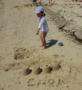 Cara at West Mersea Beach building castles