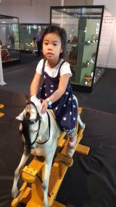 Cara at the V&A Museum of Childhood rocking horse